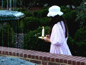 Picture of the Girl in the Gingham Dress walking in the Woodburn gardens