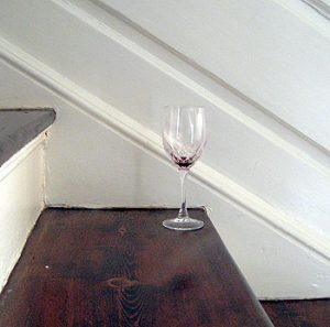 Picture of an empty glass of wine on the staircase