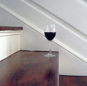 Picture of a full glass of wine on the staircase