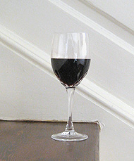 Image of a wine glass on the Woodburn steps