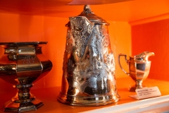 Image of an engraved silver water pitcher and other utensils