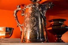 Image of an engraved silver water pitcher
