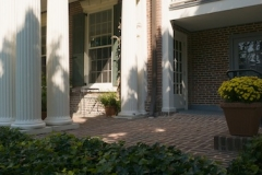 Image of the porch and side balcony from the outside of Woodburn