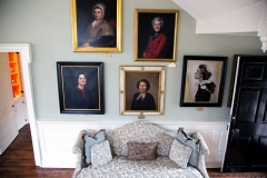 Image of the wall of first ladies and couch